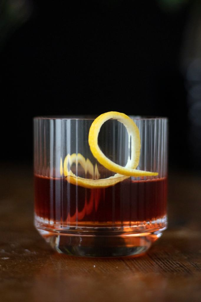 sazerac cocktail with a lemon twist