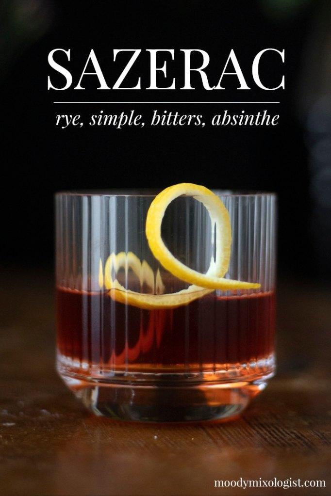 a classic Sazerac cocktail in a rocks glass with a skinny lemon twist