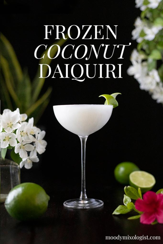 "frozen white cocktail with a lime twist on black background with white text that says ""Frozen Coconut Daiquiri"""