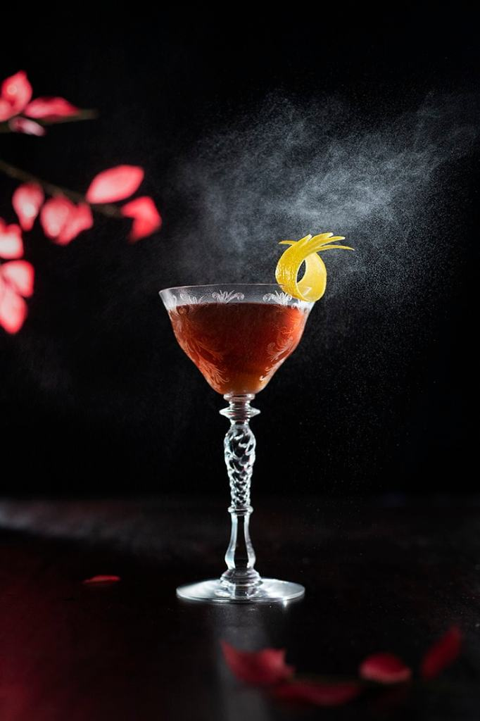 mist of absinthe washing over cocktail