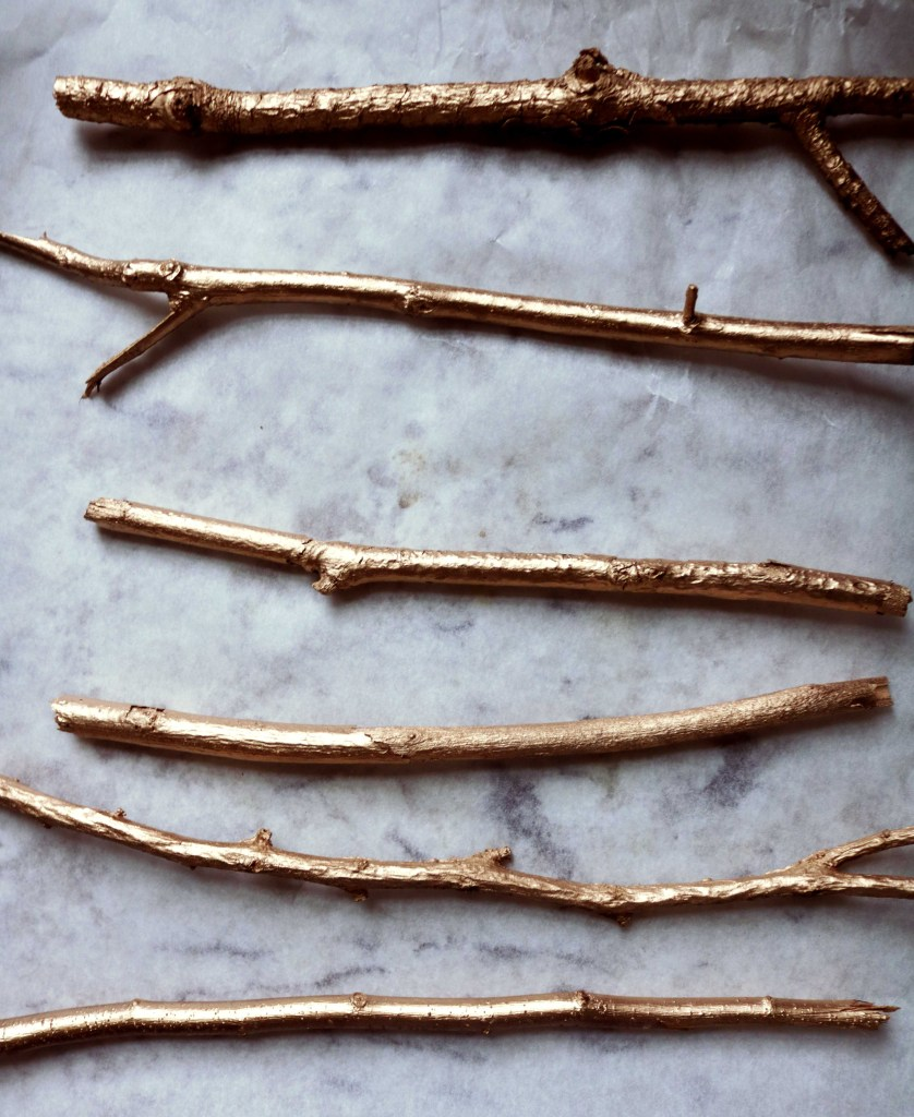 Twigs spray-painted gold.