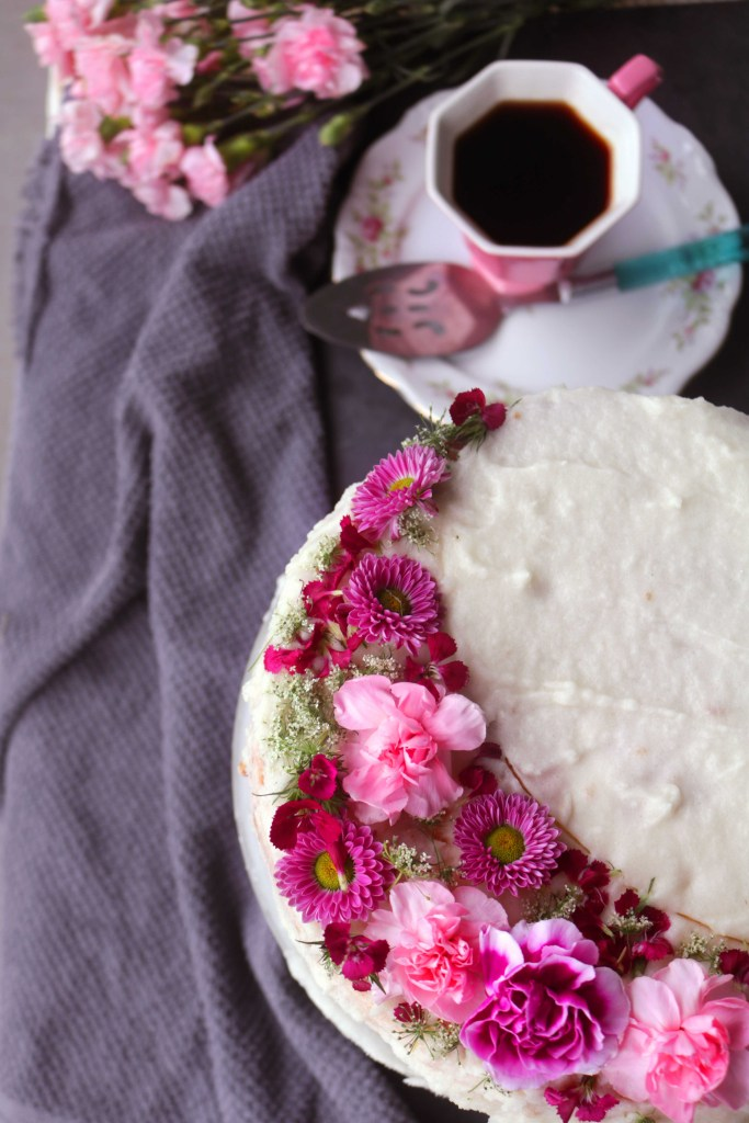 Pink Moon Champagne Cake with real pink flowers and sparkling wine.