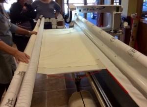 Handi Quilter longarm quilting machine loading top