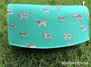 Swoon Glenda Convertible Clutch Cotton and Steel Canvas Teal Metallic Tigers Print Front Flap
