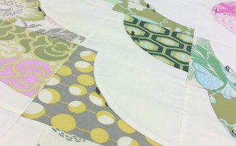 oore Approved Medallion Quilt Quilters Mixology Amy Butler Midwest Modern fabric basting safety pins close up