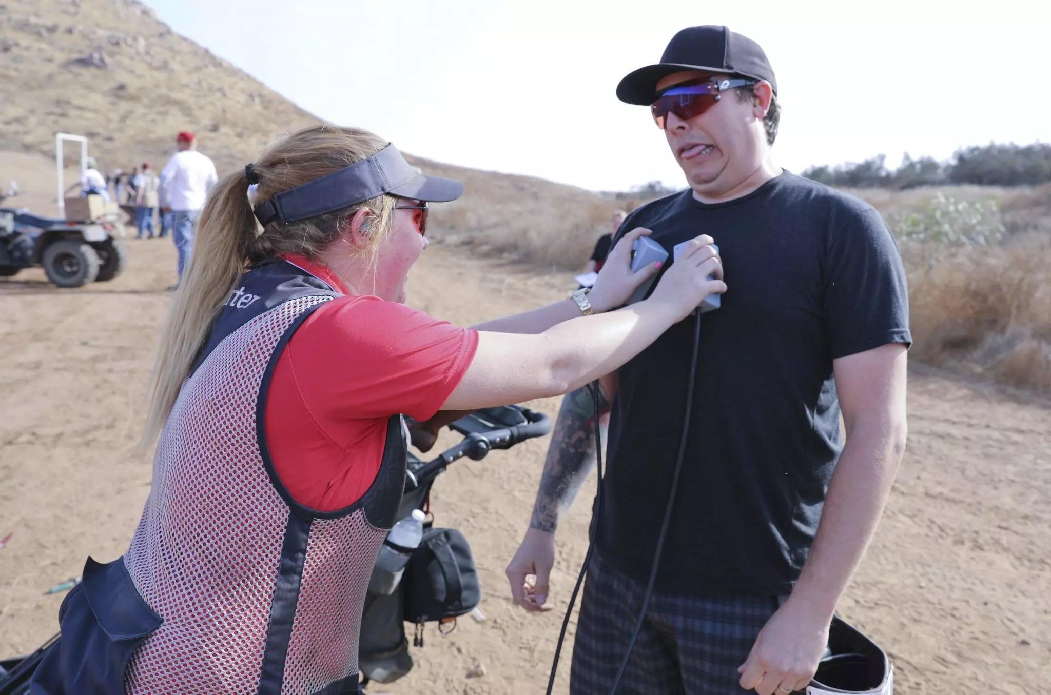 Tom Dillon takes a shot while John Burkhartsmeyer records the X's.