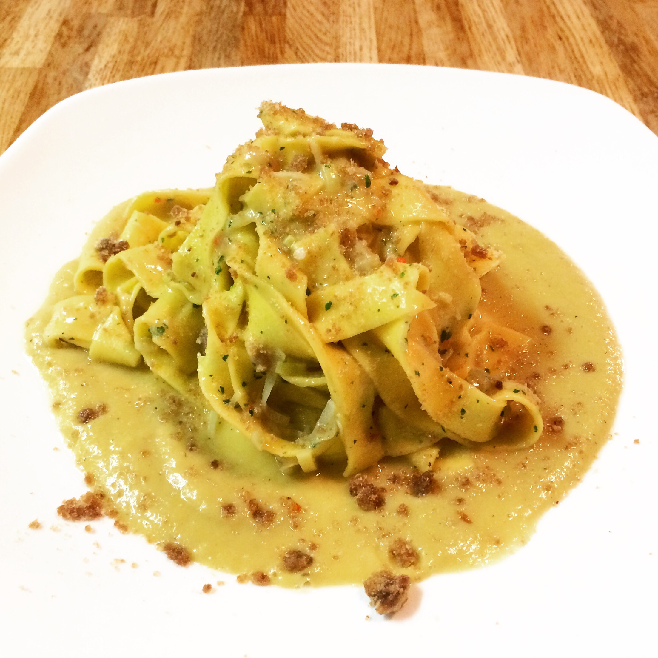 Homemade tagliatelle with leeks sauce, breadcrumbs and anchovies