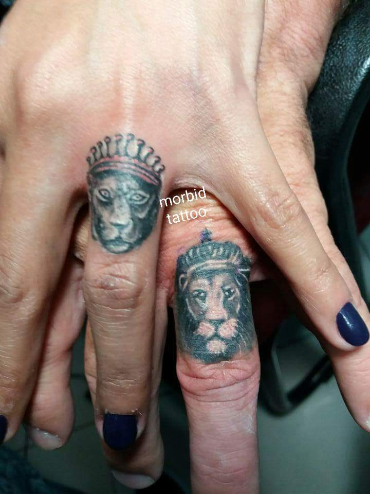 Lion and lioness finger tattoos for Finger lion tattoo