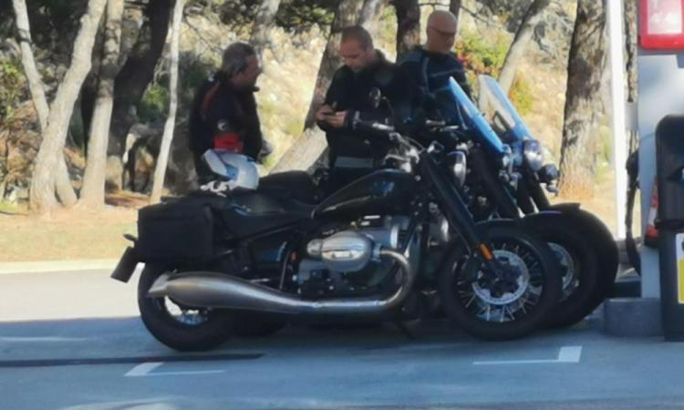 Two BMW R18 cruiser motorcycles caught on camera.