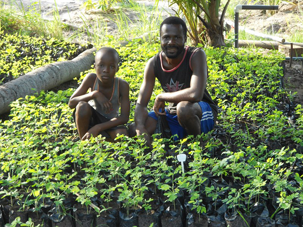 Adolf Amegayie and son with their seedlings