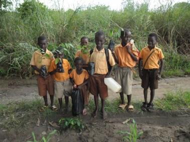 SCHOOL CHILDREN WITH SEEDLINGS