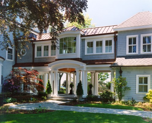 """Tuscan columns frame the """"gateway"""" created by this addition."""