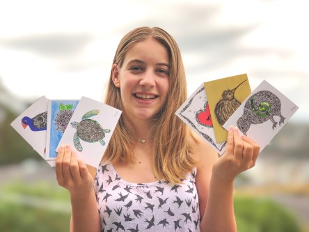 Zoe holding her cards