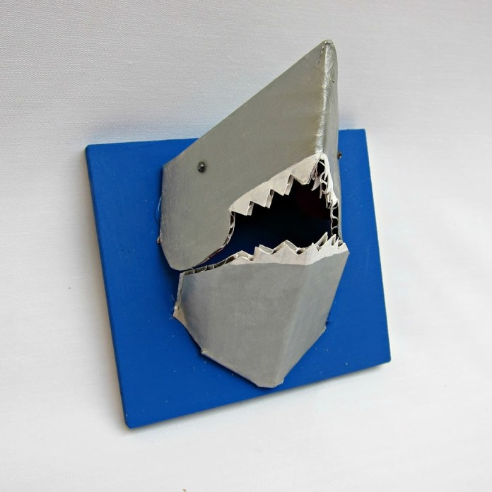 Make a 3-D shark jewelry holder from cardboard. Between all those teeth and the head you can hang quite a few items on this tiny but mighty shark.