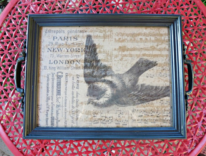 Make decorative trays from thrifted art and frames found at Goodwill San Antonio. A fun way to make your own home decor on a budget!