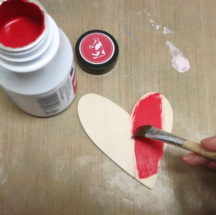 red milk paint on wood heart