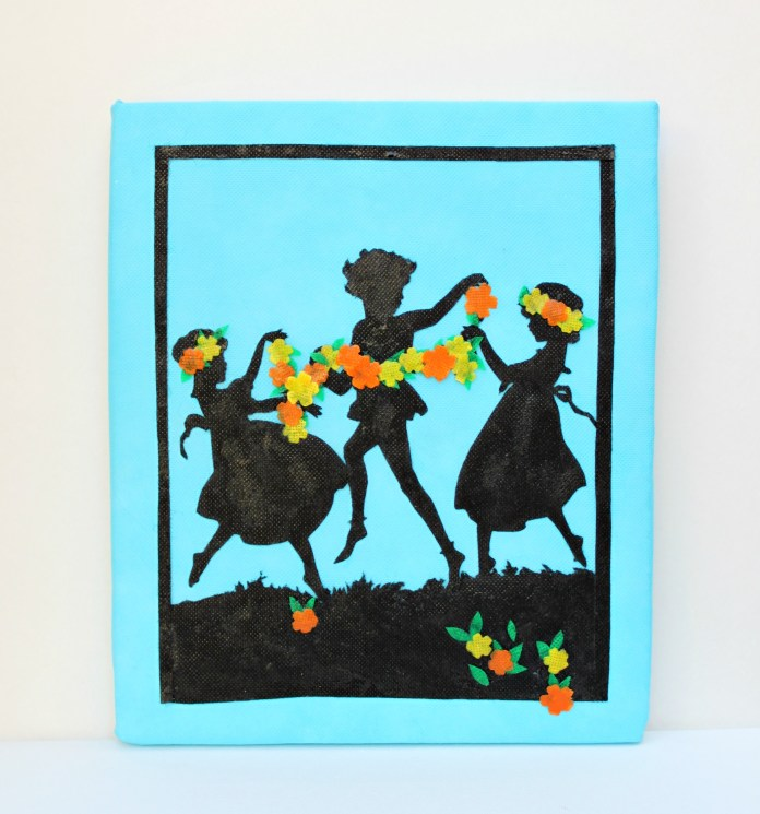 Create detailed silhouette wall art by using non fraying fabric and foam boards.