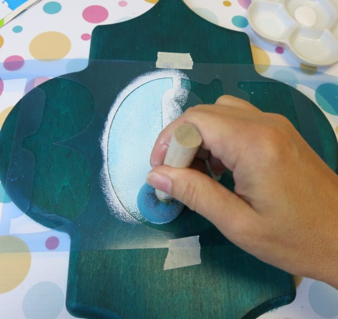 Stencil a letter onto wood