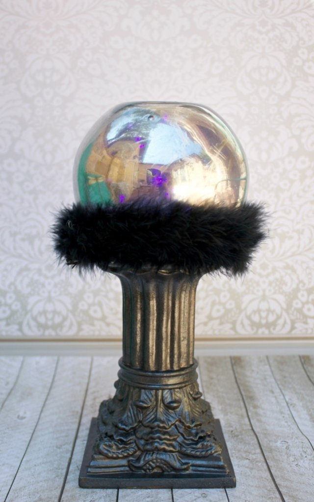 Combine thrift store items with purple party lights to create an amazing crystal ball that glows! This fun Halloween craft project makes great decor!