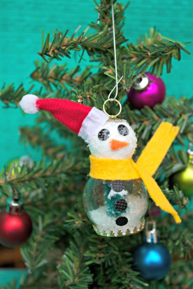 This delightful snowman snow globe ornament is a treat for adults and kids alike!