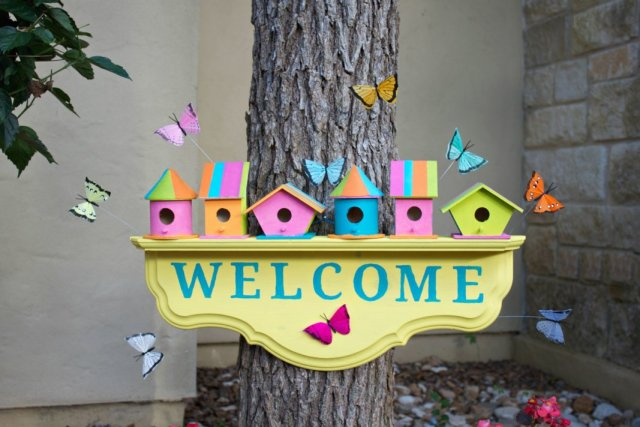 Create a colorful birdhouse welcome sign to greet springtime and guests to your home. This cheery project is a fun simple craft.