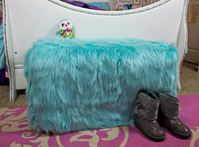 Transform an outdated ottoman from Goodwill San Antonio into a fun piece of dorm decor in under one hour! This ottoman slipcover DIY is Easy to make.