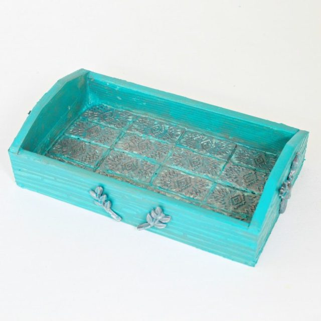 Use various Mod Podge products like collage clay, stencils, Mod Melts, and Mod Molds to make a detailed, colorful jewelry tray.