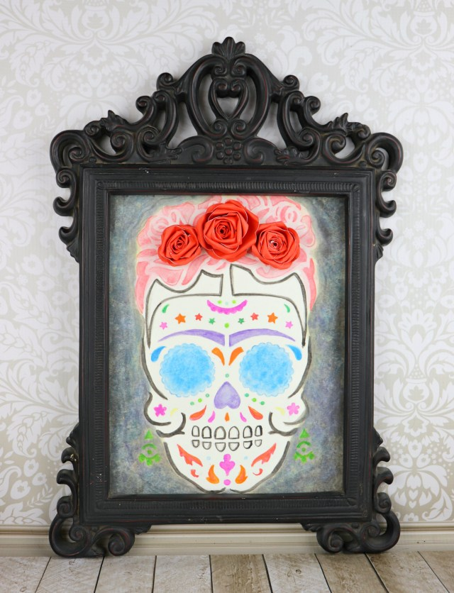 You can use this sugar skull watercolor wall art for Halloween, Dia de los Muertos, or even for a Coco themed party!