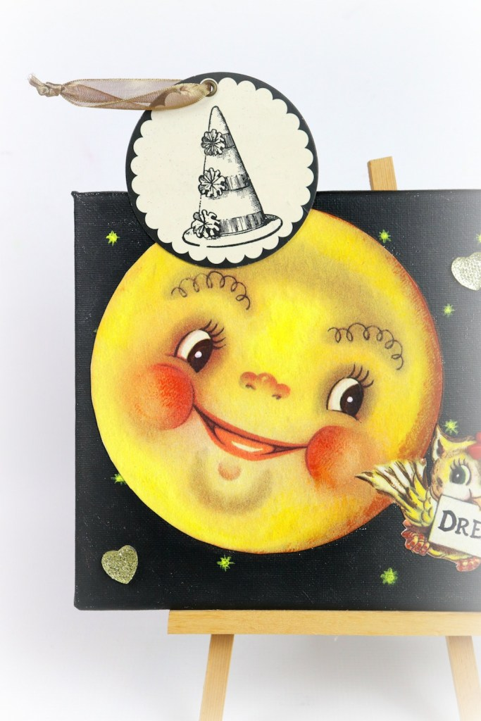 """Make a mixed media owl and moon wall art to encourage little ones to """"dream big"""". This cute piece of decor is easier to make than you realize!"""