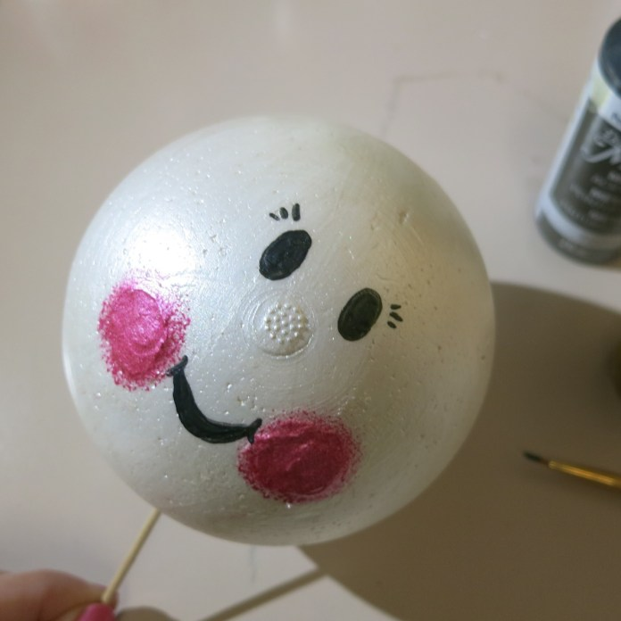 add details to the snowman face
