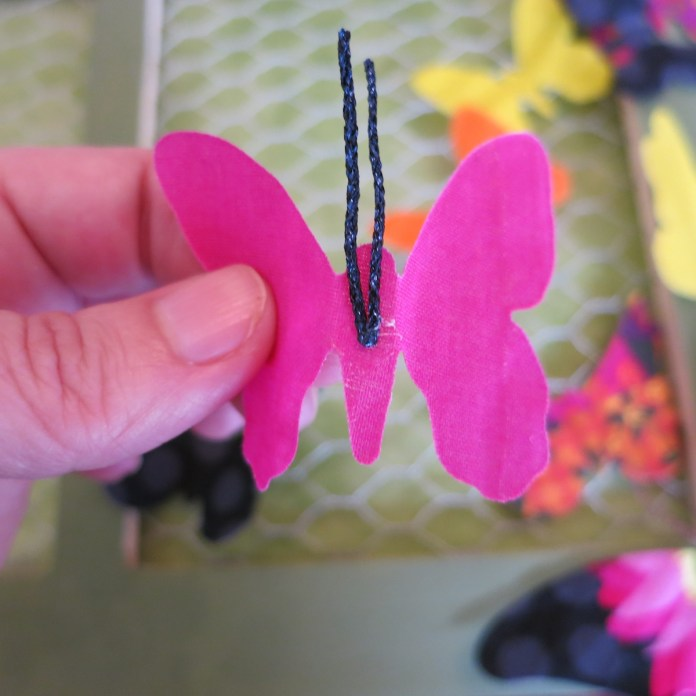 glue antennae to fabric butterfly