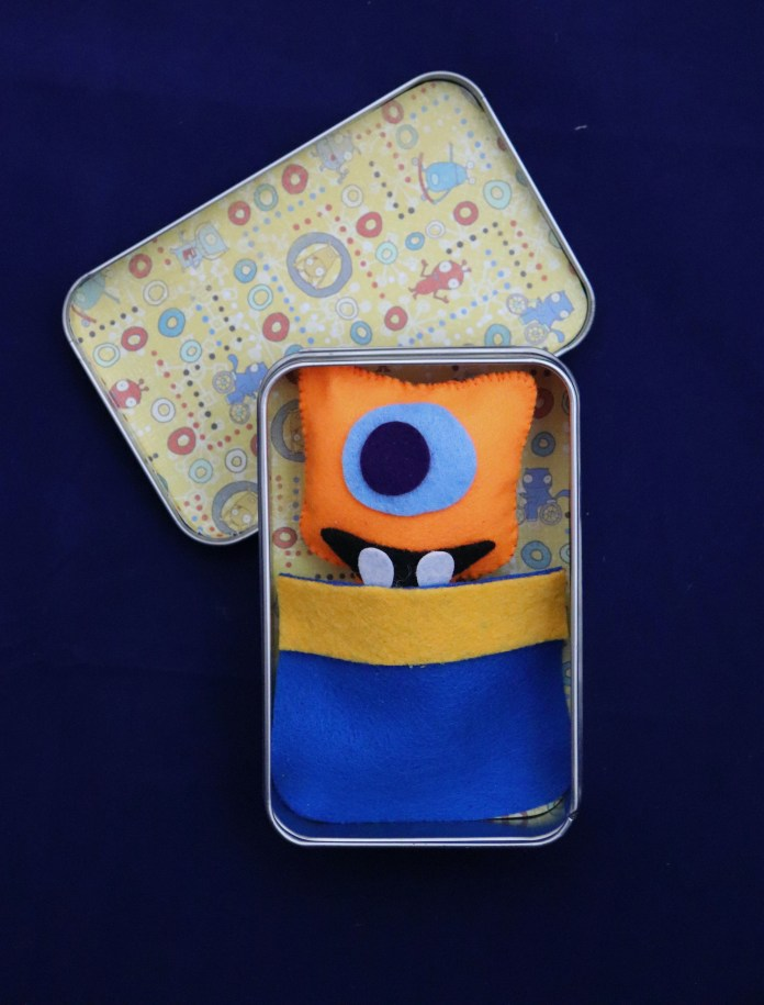 monster plush in a tin