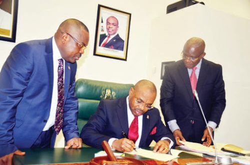 Akwa Ibom Finance Commissioner, Linus Nkan with Governor Emmanuel