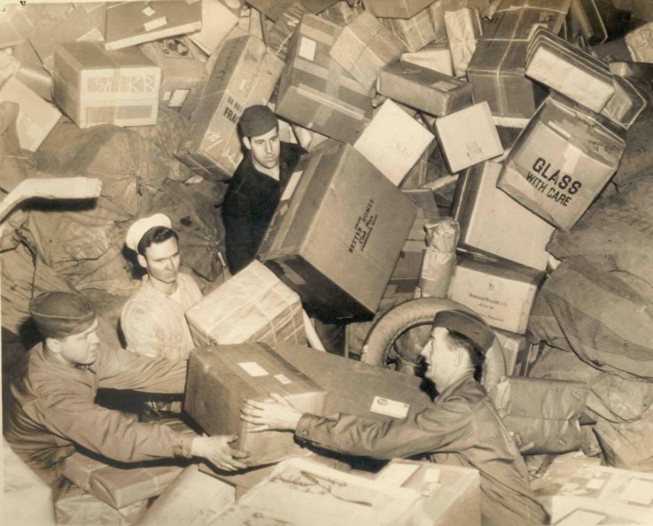 1944-U_S_ troops almost buried by parcels do their best to handle that year_s holiday mail-A_2008-51