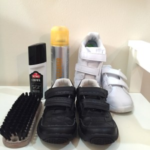 Back to school tip - school shoes, shoe cleaners and brushes laid out to clean shoes
