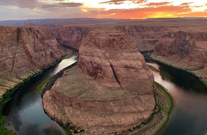 The Best 2 Things To Do in Page Arizona as featured by top US family travel blog, More than Main Street; Horseshoe Bend in Page Arizona at sunset.