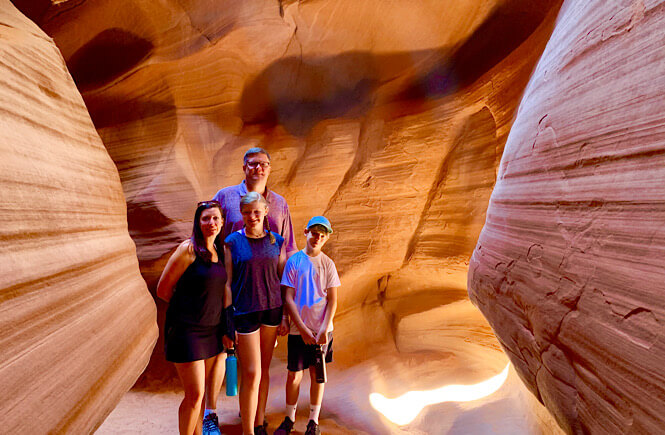 The Best 2 Things To Do in Page Arizona as featured by top US family travel blog, More than Main Street; family in upper antelope canyon