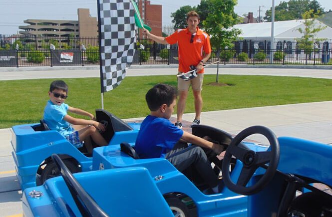 Top 15 best unique spring break vacations in the US for families featured by US family travel blog, More Than Main Street: racetrack in Indianapolis, Indiana.