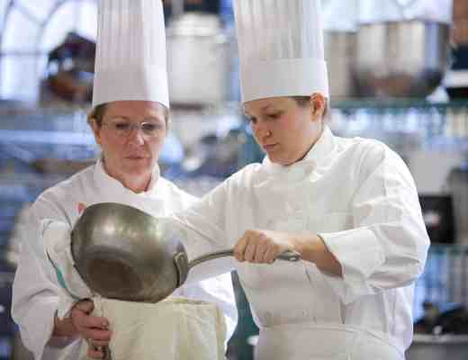 Lucretia and Ashley Norman work together in the kitchen during Bistro Boot Camp at The Culinary Institute of America in Hyde Park, NY.