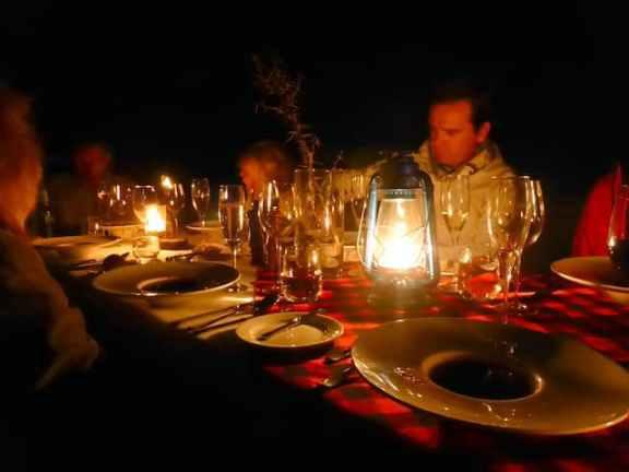 Bush dinner with candlelight at Mahali Mzuri Safari Camp in Kenya