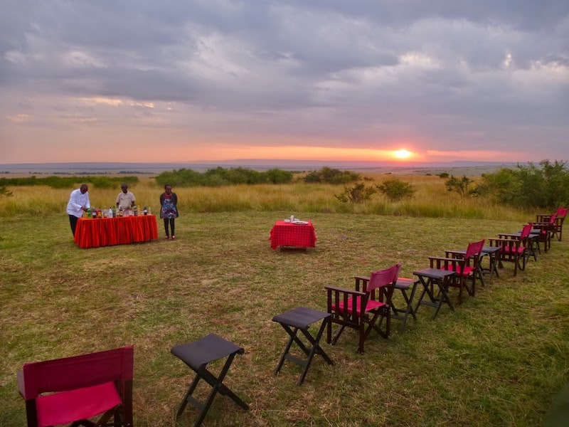 Setting up a bush dinner at sunset