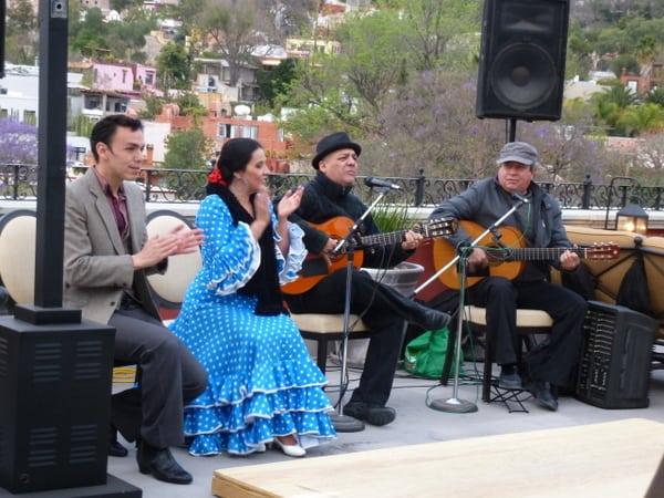 Musicians and flamenco dancers entertain at the Luna bar