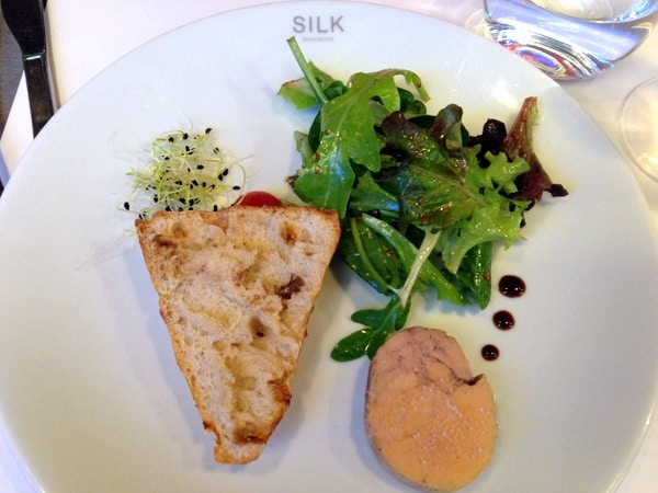 Half-portion of duck foie gras with toast and salad