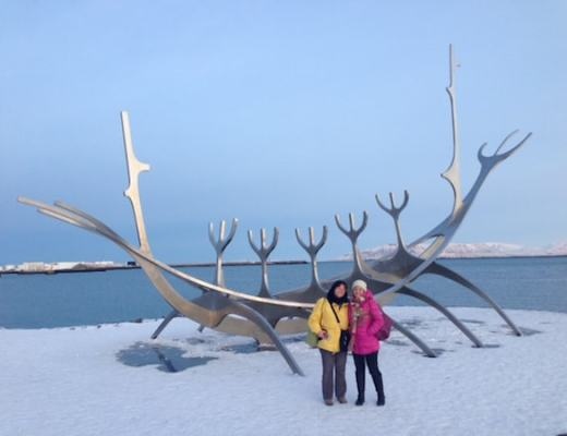 Linda and Nancy beside an elegant Viking boat sculpture along the harbor in Reykjavik