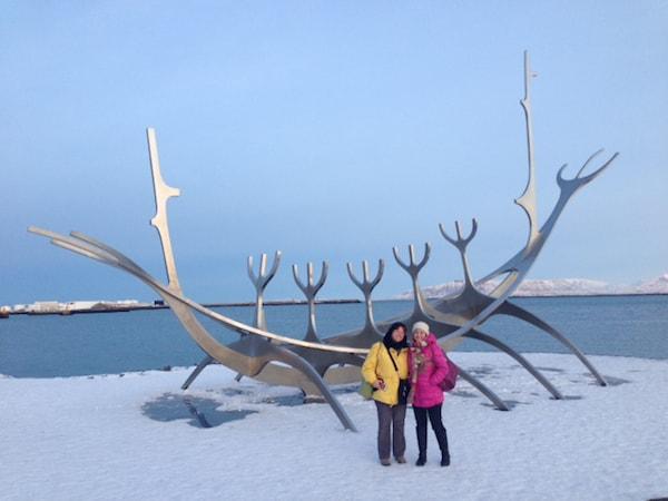 Linda and Nancy beside an elegant Viking boat sculpture along the harbor in Reykjavik