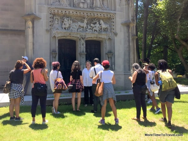 City College students learn about the history of the Belmont Mausoleum from historian Susan Olsen at The Woodlawn Cemetery