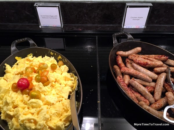 Scrambled eggs with heirloom tomatoes and chicken-apple sausages