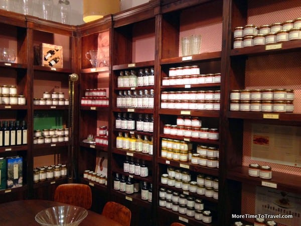 Shelves of sauces, truffle preparations and other specialty foods in the dispensa