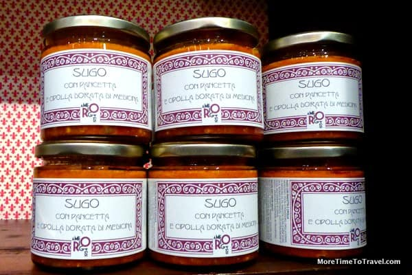 Jars of tomato sauce made with Modena bacon and golden onions on the shelf of the dispensary