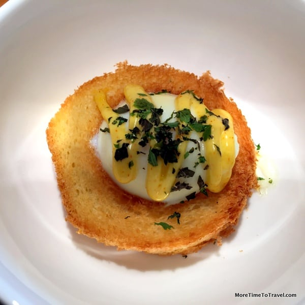 Egg in a hole with Hollandaise and herbs